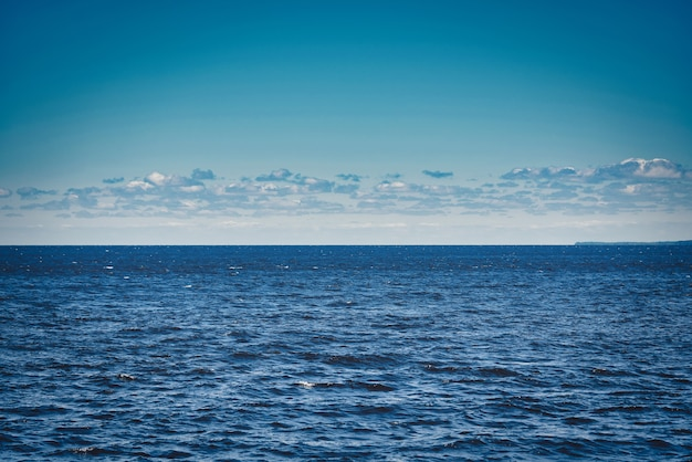 Marine horizon line in the middle of the frame. sky and water converge on the horizon