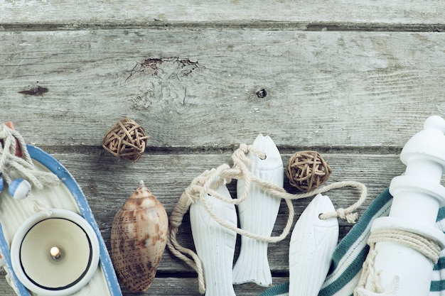 Marine items on old wooden background