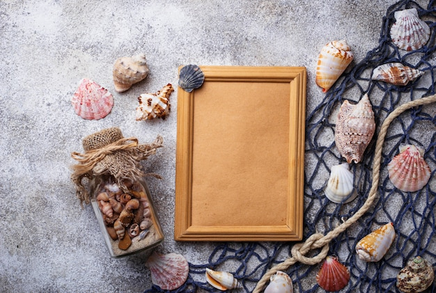 Marine items: sea shells, rope, fishnet. nautical background. space for text