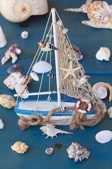 Marine life with seashells and fishing boat