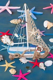Marine life with seashells,  starfish and boat