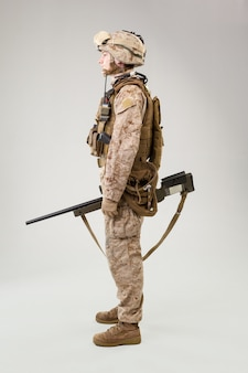 Marine rifleman in combat uniform, helmet and body armor