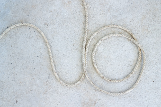 Marine rope spiral on concrete floor at boat station in koh mak in trat, thailand.