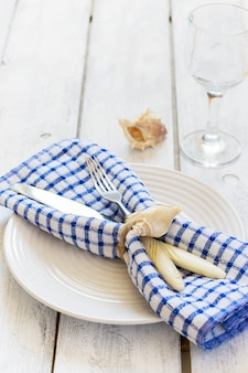 Marine style table setting on a white background with boards
