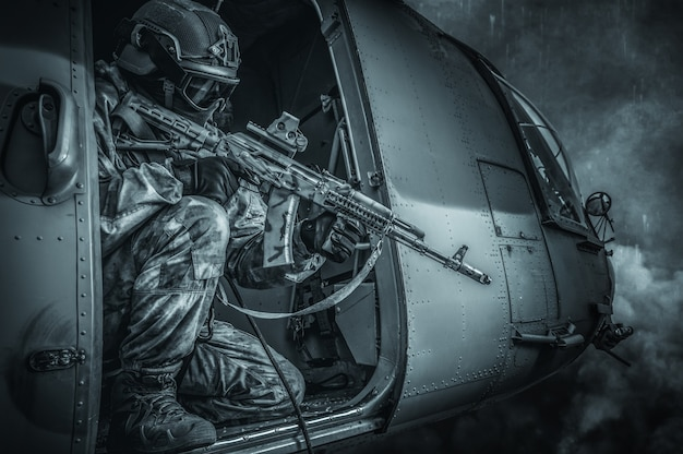 Marine takes aim at a rifle scope from a flying helicopter. the concept of military conflicts. mixed media