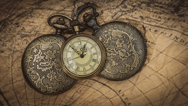 Maritime compass and  watch on map