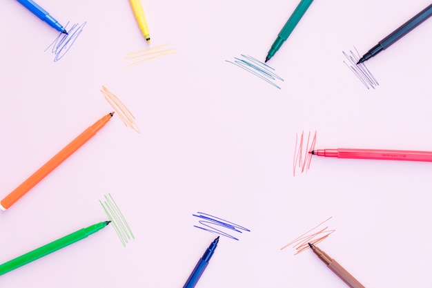 Marker pens lying near strokes