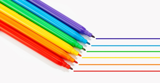 Markers of rainbow colors isolated on white