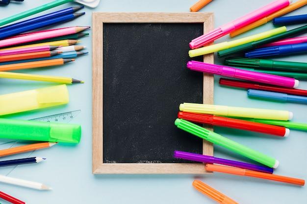 Markers on top of chalkboard slate