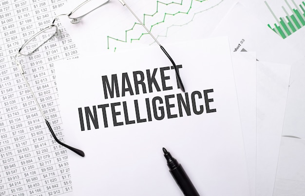 Market intelligence . conceptual background with chart ,papers, pen and glasses