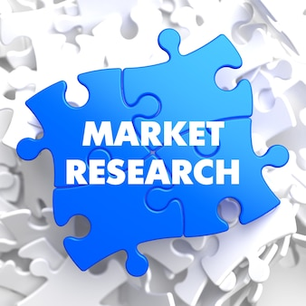 Market research on blue puzzle on white background.