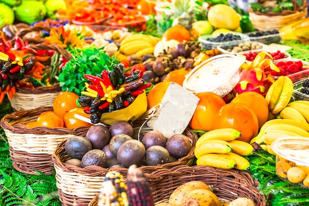 Market with vatiety of tropical fruits in campo di fiori, rome