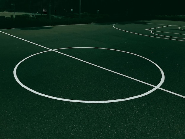 Marking on a green basketball court a sports concept