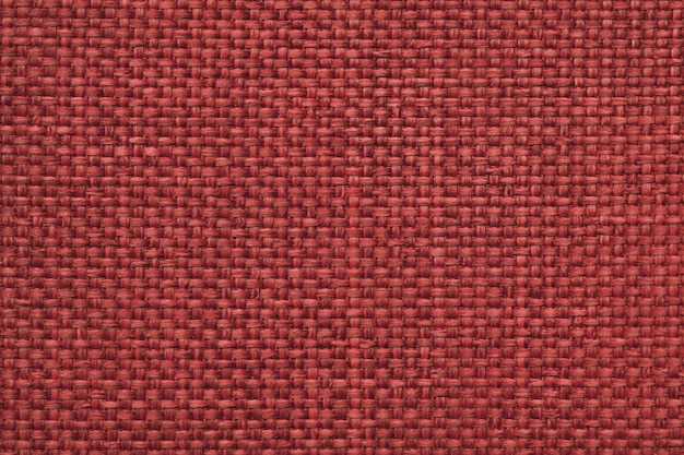 Maroon background with braided checkered pattern, closeup. texture of the weaving fabric, macro.