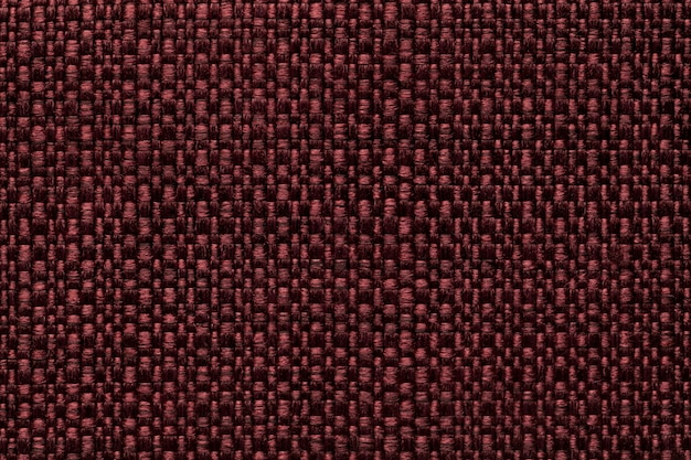 Maroon textile background with checkered pattern,  structure of the red fabric