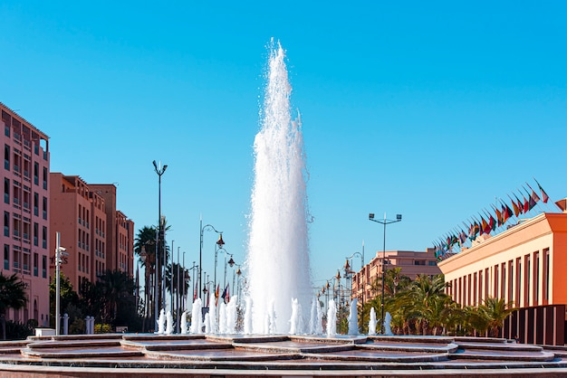 Marrakesh or marrakech, modern street, part of city with tall fountain, morocco