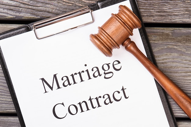 Marriage contract and legal gavel.