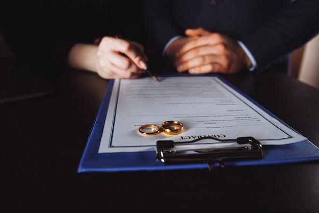 Marriage contract sign concept. man and woman signing documents.