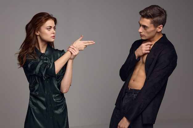 Married couple conflict gray background jacket model. high quality photo