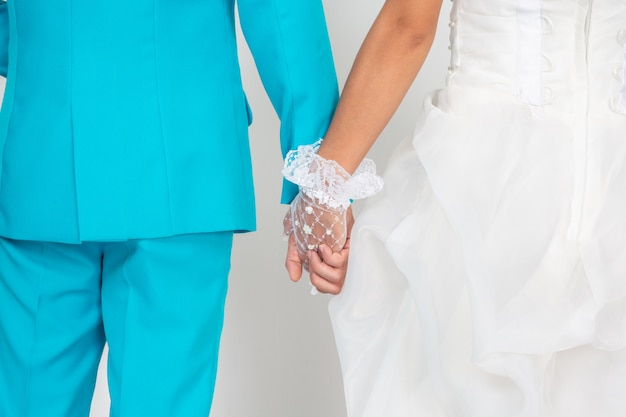 Married couple holding hands.