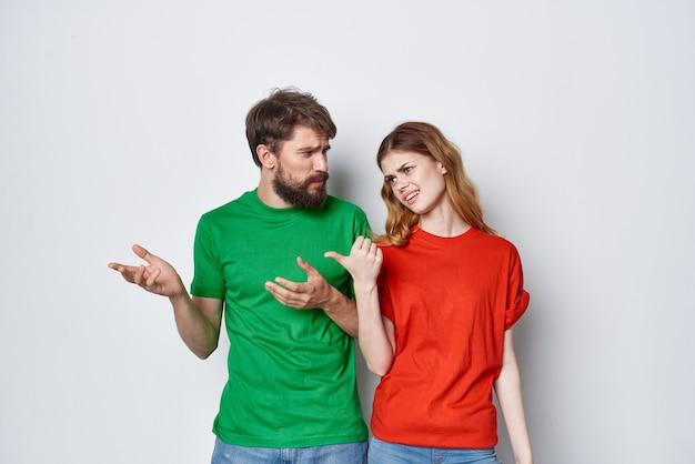 Married couple hug friendship colorful tshirts family studio lifestyle