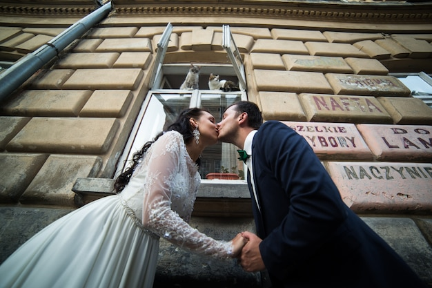 Married couple kissing in street