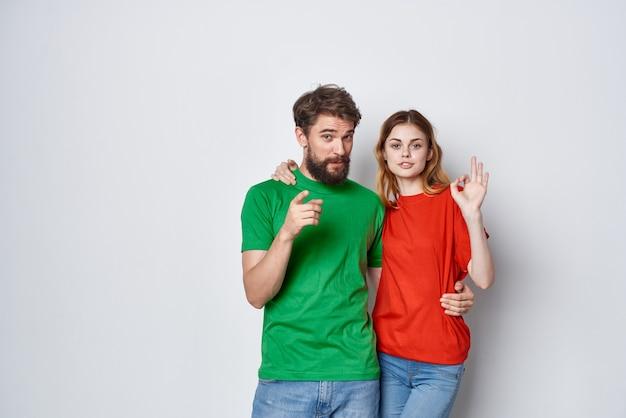 Married couple multicolored tshirts communication quarrel studio lifestyle