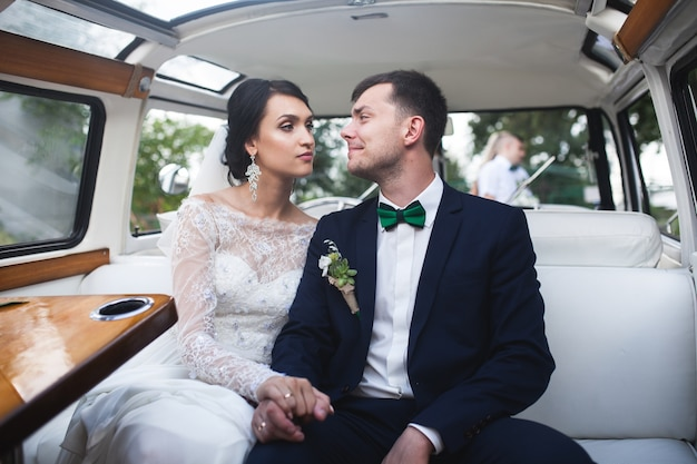 Married couple posing in car