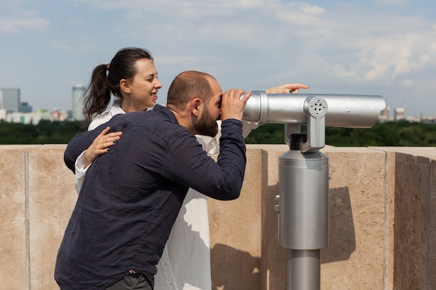 Married couple spending relationship anniversary on building rooftop
