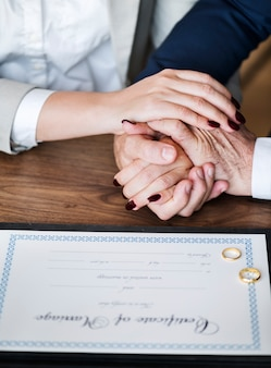 Married elderly couple with marriage certificate