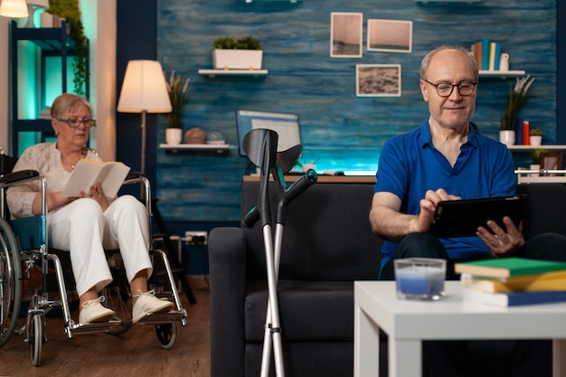 Married old couple enjoying retirement in living room