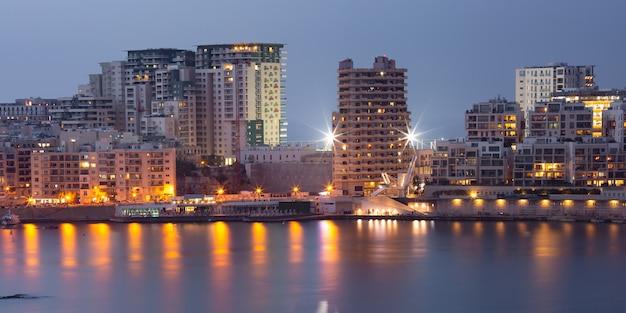 Marsamxmett harbour and silema city at night, malta
