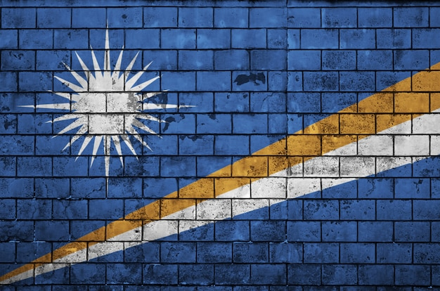 Marshall islands flag is painted onto an old brick wall