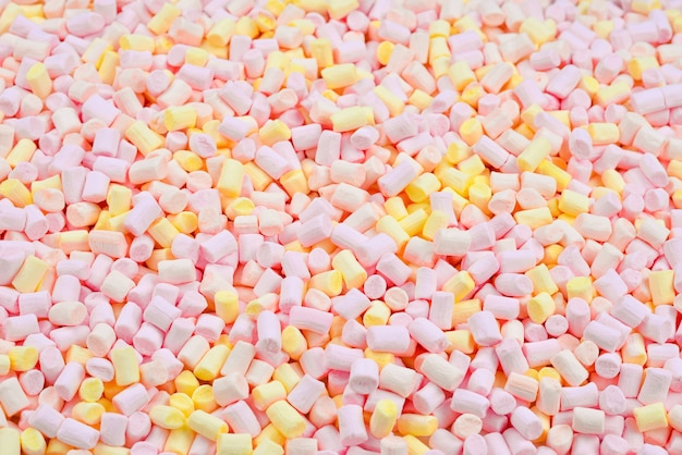 Marshmallow. background of pink and yellow colorful mini marshmallows.
