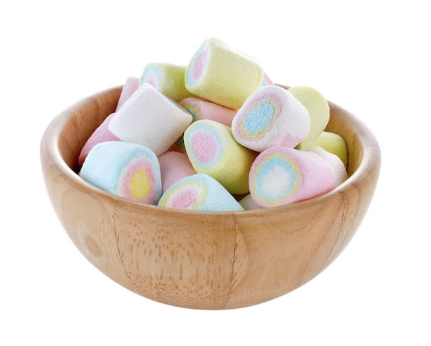 Marshmallow candy in wood bowl on white background
