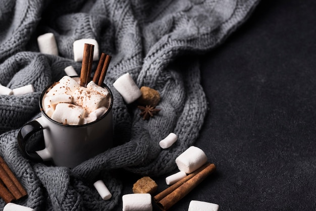 Marshmallow drink with cinnamon on table