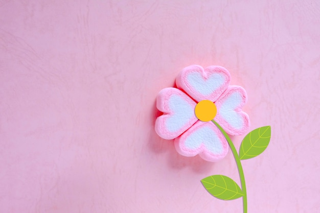 Marshmallow flower on pink background, sweet background