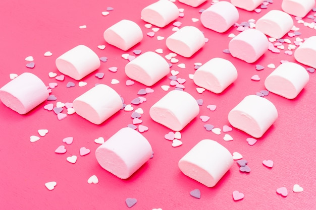 Marshmallow pattern on pink surface