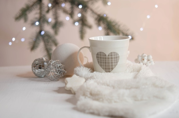 Marshmallows, christmas balls, cookies and white fur on a pink background