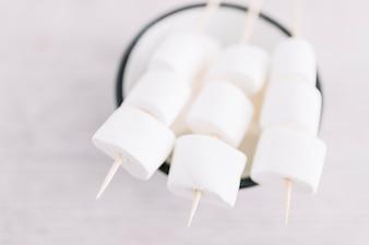 Marshmallows on sticks on cup