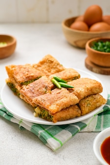 Martabak telor or martabak telur. savory pan-fried pastry stuffed with egg, meat and spices. martabak telur is one of indonesia street food
