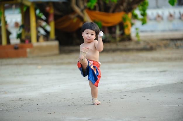 Martial arts of muay thai,thai boxing thailand,outdoor portrait cute baby boy.