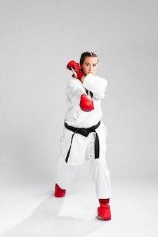 Martial technique and box gloves on white background