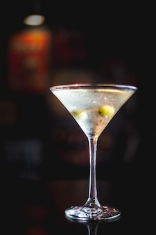 Martini drink in a dark ambient