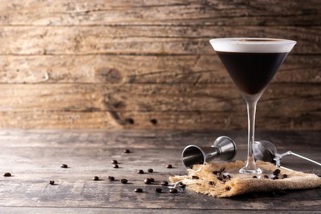 Martini espresso cocktail in glass on wooden table