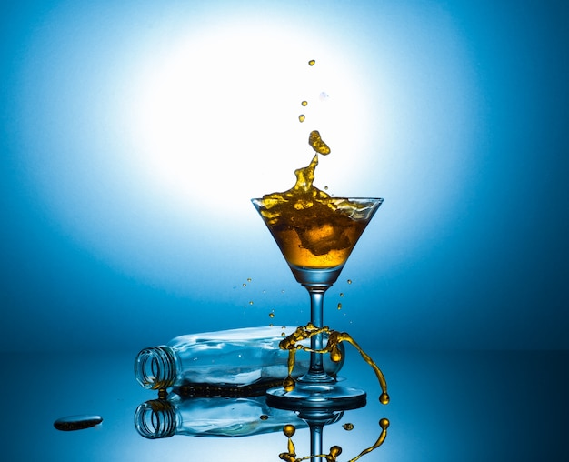 Martini and flat bottle with alcohol