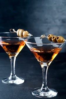 Martini glass and olives
