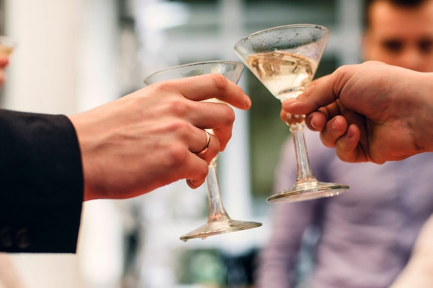 Martini glasses in the hands of celebrating the holiday