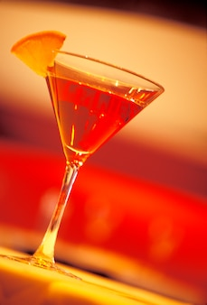 Martini with lemon wedge garnish