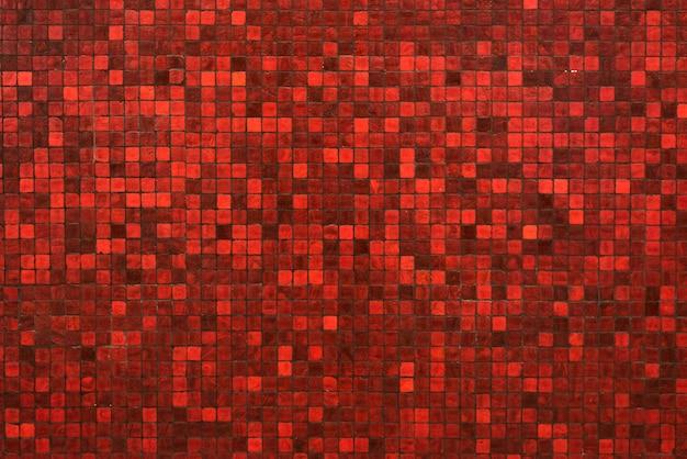 赤いmasaic風化された色調のテクスチャの背景